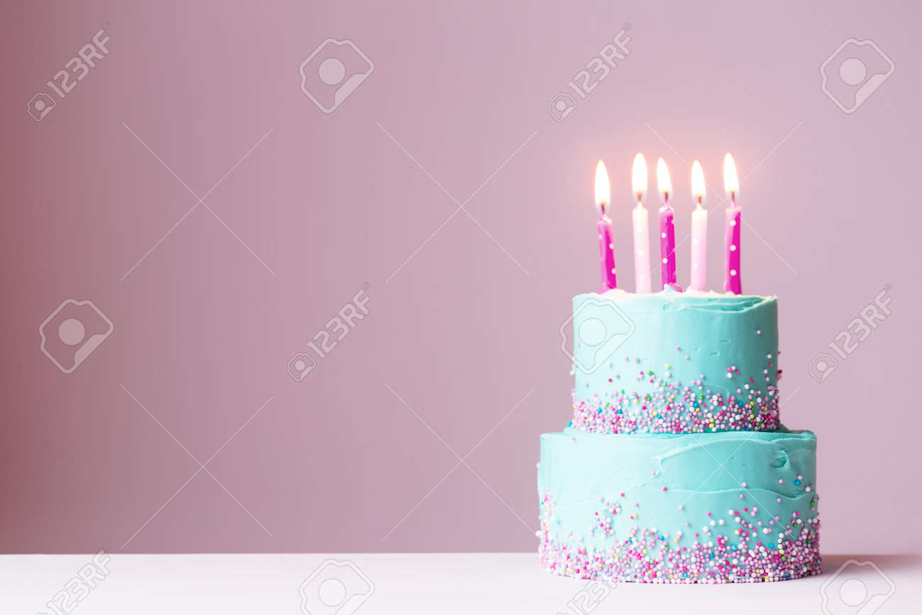 Sensational Tiered Birthday Cake With Pink Candles Stock Photo Picture And Funny Birthday Cards Online Inifofree Goldxyz