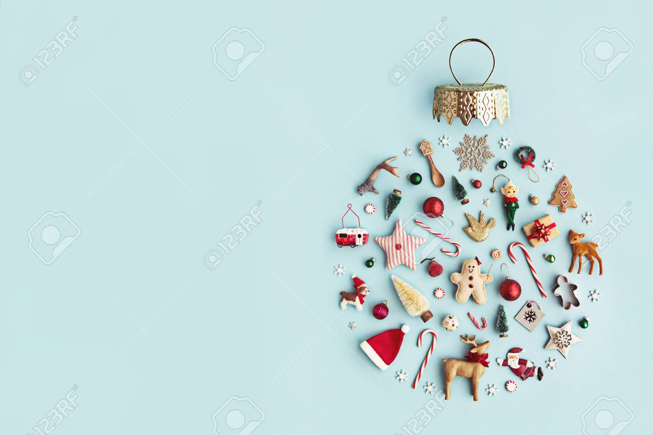 Christmas objects laid out in the shape of a Christmas bauble, overhead view - 88260325