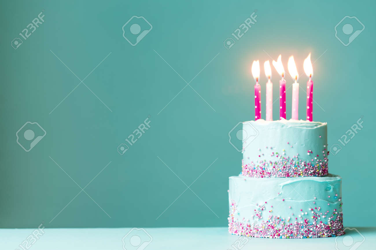 Stupendous Tiered Birthday Cake With Pink Candles And Sprinkles Stock Photo Funny Birthday Cards Online Alyptdamsfinfo