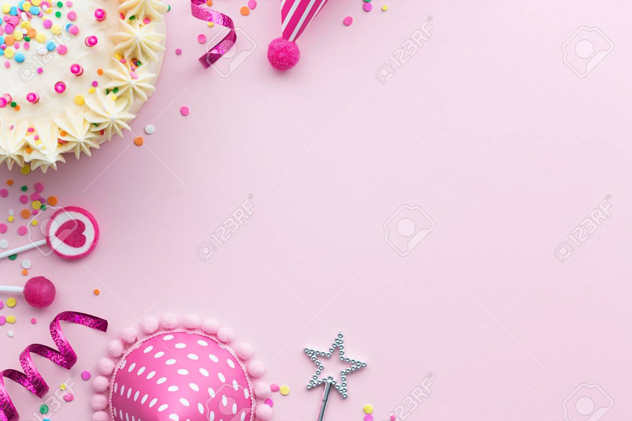 Pink Birthday Party Background With Cake And Hats Stock Photo