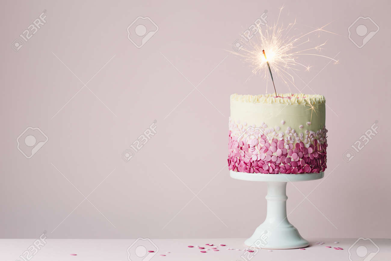 Birthday Cake With Pink Sprinkles And Sparkler Standard Bild