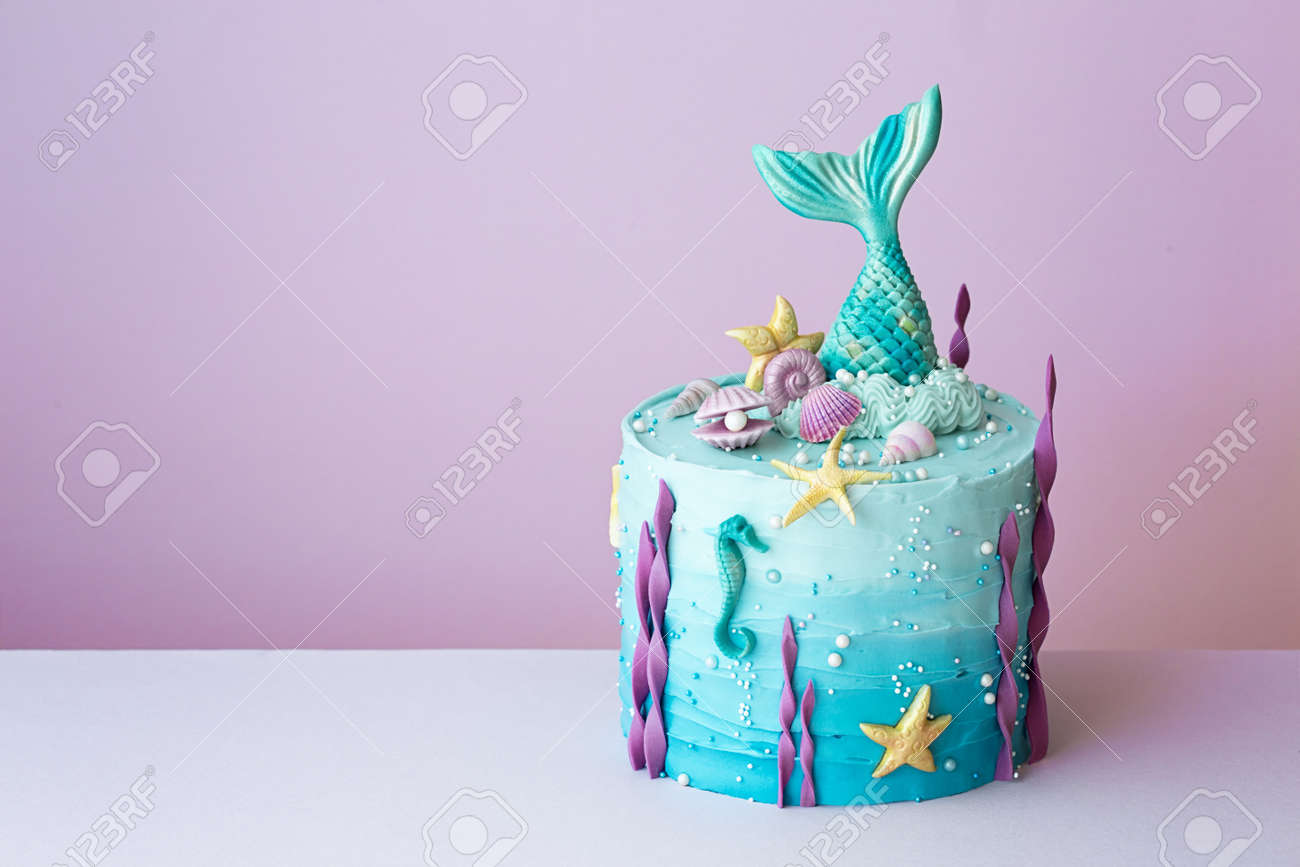 Cool Mermaid Birthday Cake On A Purple Background Stock Photo Picture Funny Birthday Cards Online Fluifree Goldxyz