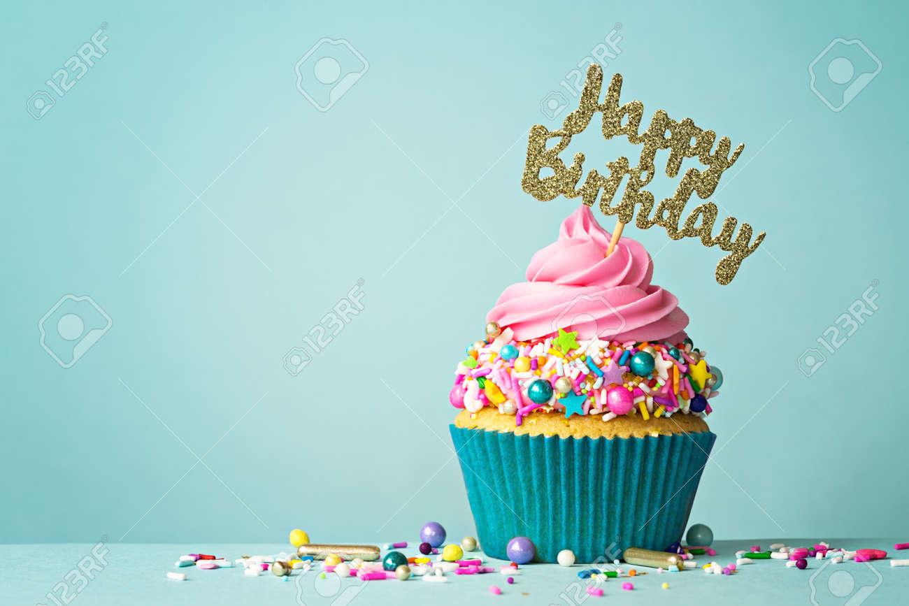 Celebration cupcake with happy birthday message - 131361654