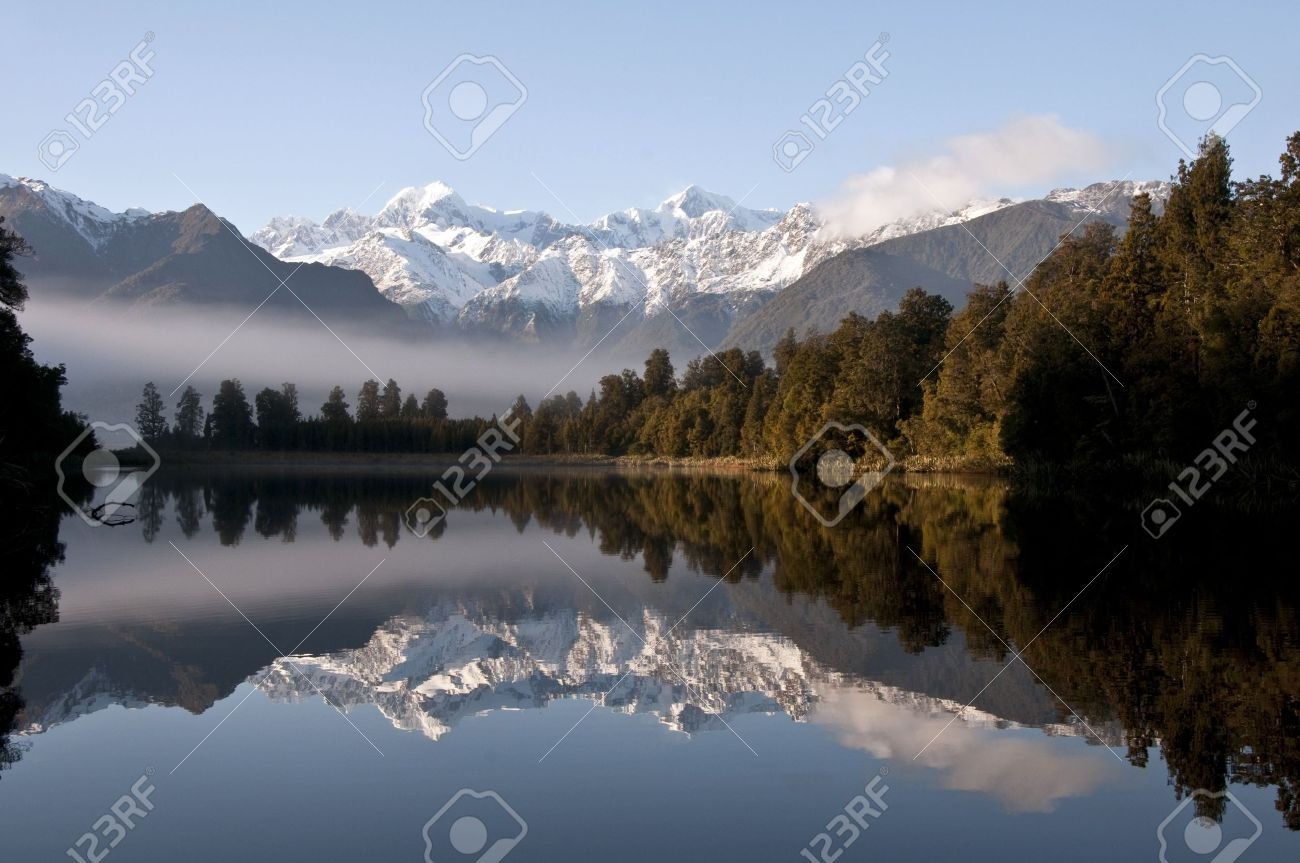 Lake Matheson, South Island, New Zealand - Reflection of Mount Tasman and Mount Cook Stock Photo - 9640921
