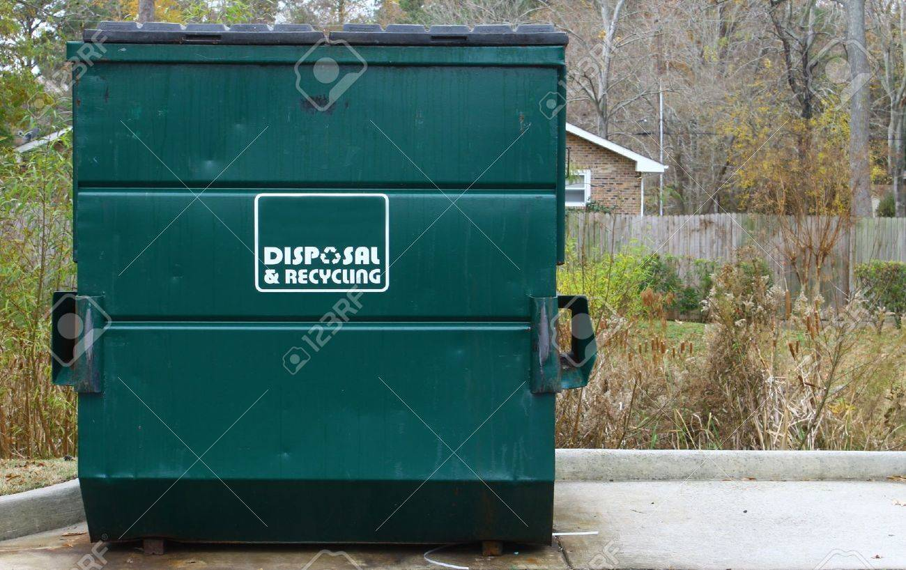 A large green disposal and recycling dumpster parked outside on a concrete slab Stock Photo - 16711460