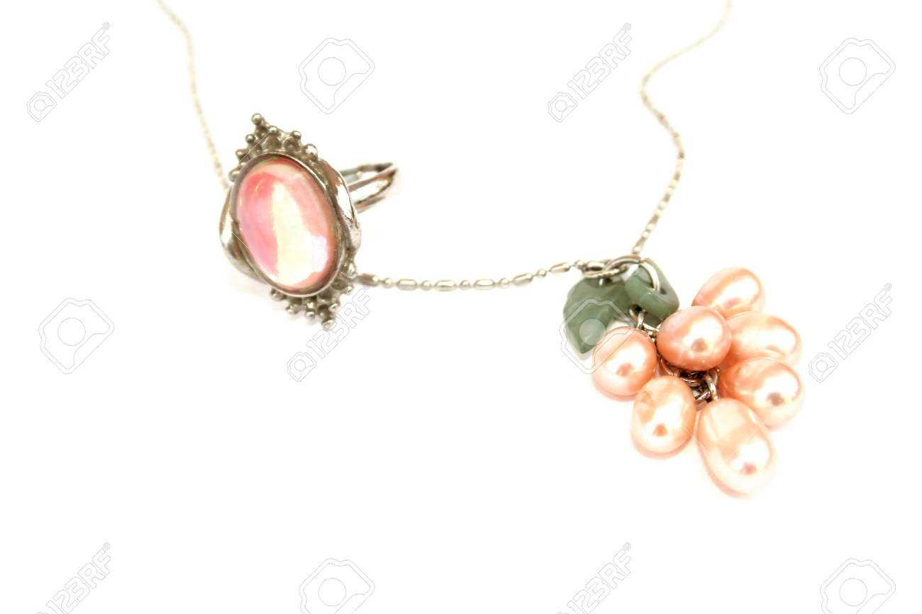 Pink ring and necklace isolated on the white. Stock Photo - 1398489