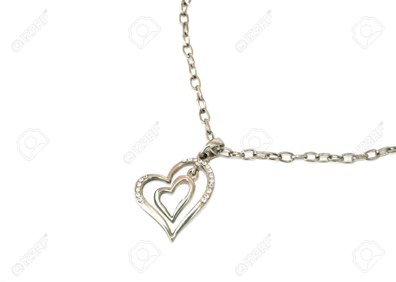 Two hearts with stones and necklace isolated on the white. Stock Photo - 1398624