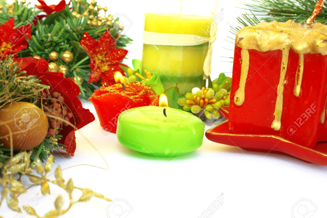 Christmas ornaments.Candles,holly berry,fir-tree. Stock Photo - 2096812