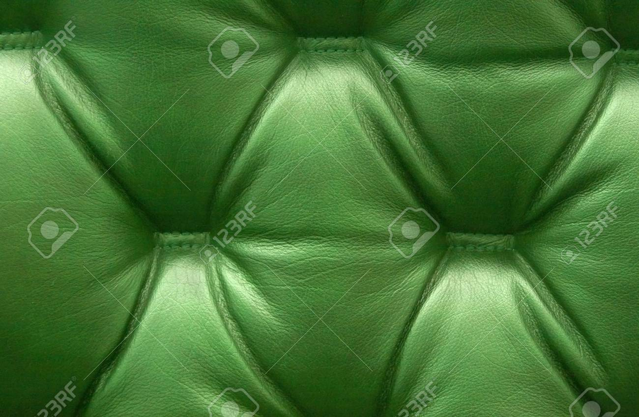 Green leather upholstery as a background. Stock Photo - 4698671