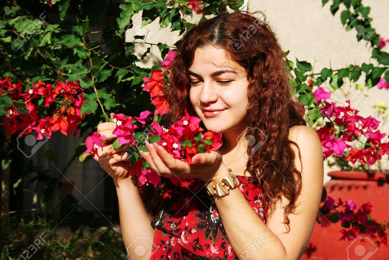 Pretty brunette woman with bougainvillea flowers. Stock Photo - 16013946