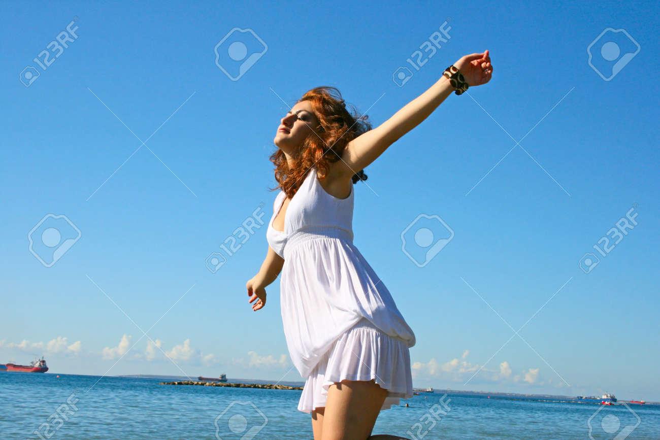 Pretty woman in white dress on beach in Limassol, Cyprus. Stock Photo - 16521081