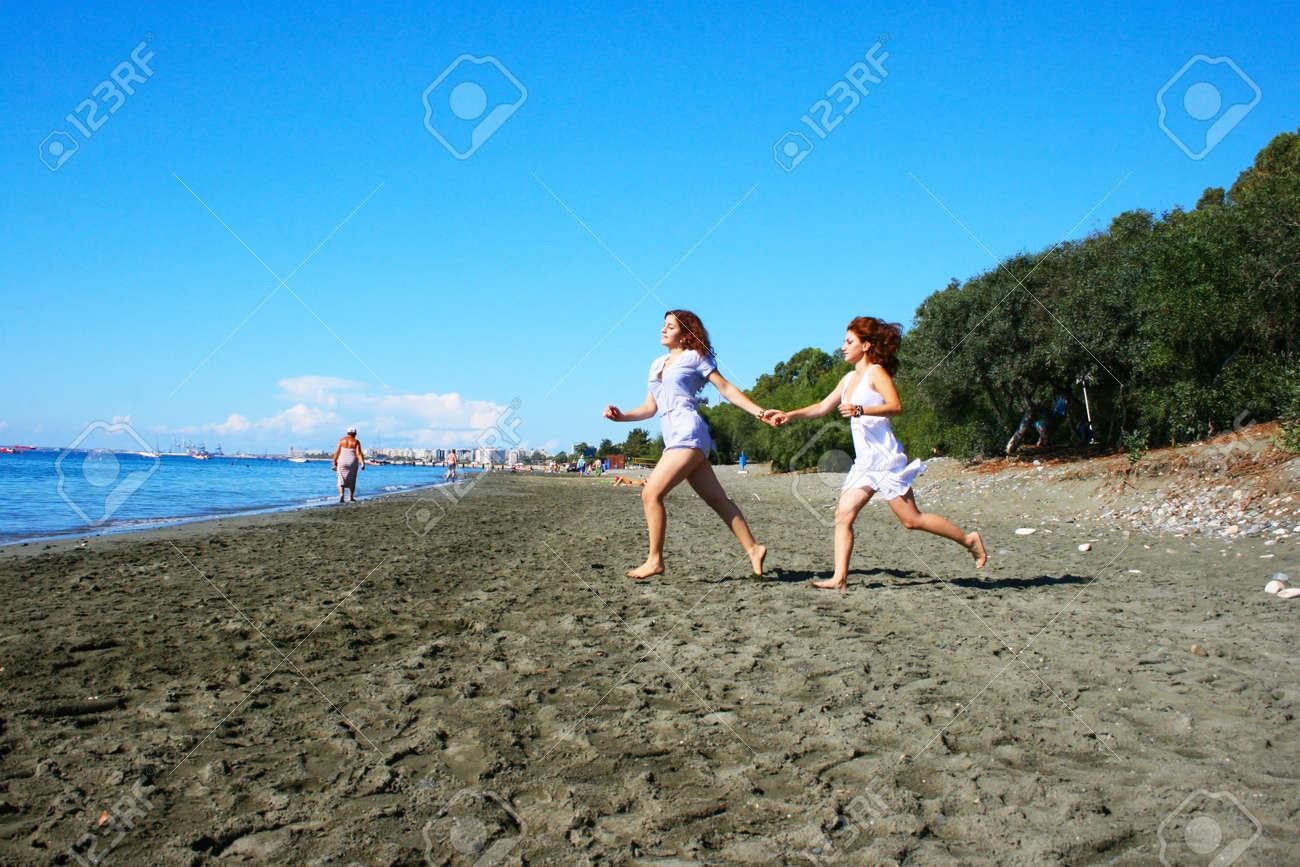 Two women on beach in Limassol, Cyprus. Stock Photo - 16902441