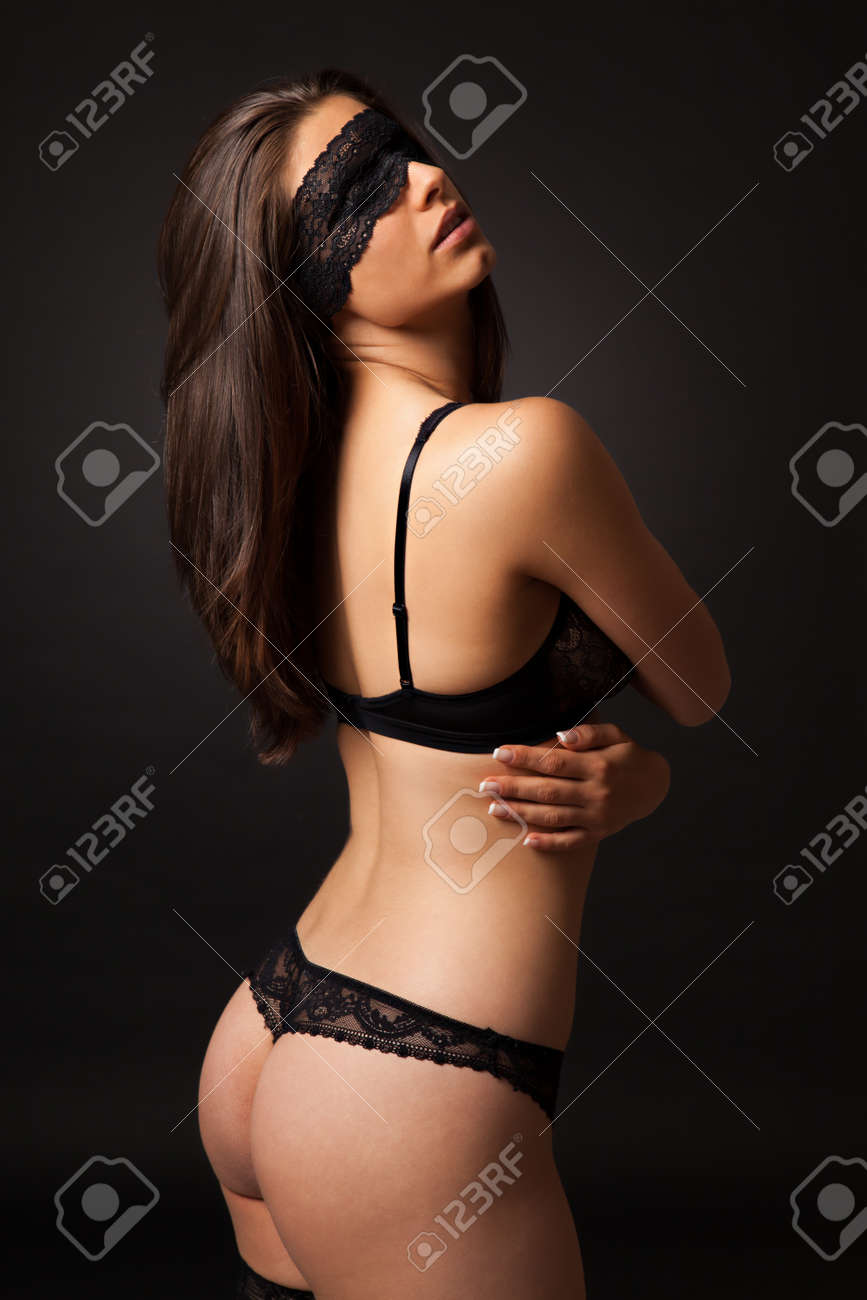 041bfbf4a Beautiful sexy woman with black lingerie and blindfold on black background  Stock Photo - 46165212