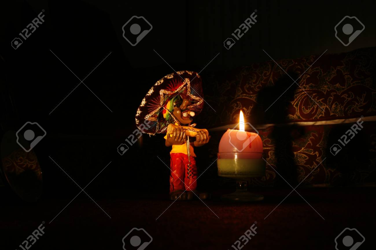 Doll with corkscrew, illuminated by a candle light at night Stock Photo - 12539534