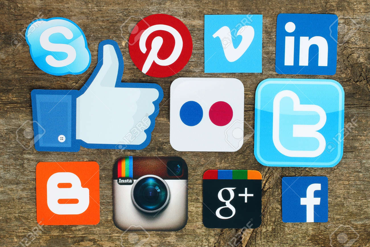Kiev, Ukraine - April 15, 2015:Collection of popular social media logos printed on paper:Facebook, Twitter, Google Plus, Instagram, Skype, Pinterest and Blogger on old wooden background - 50730353