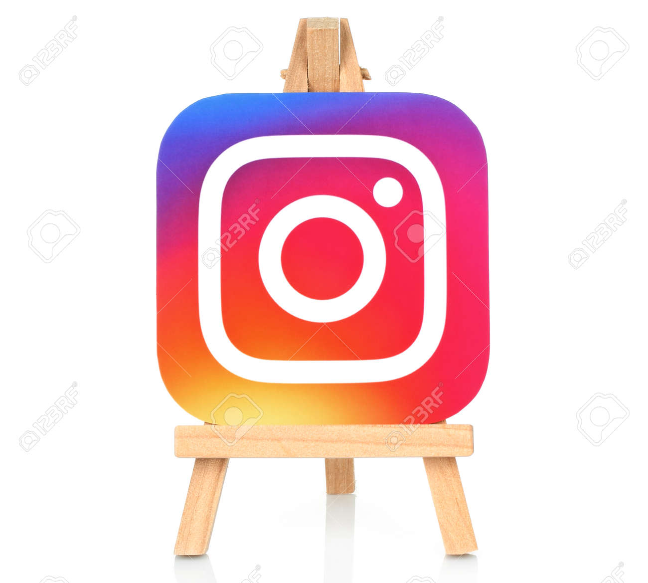 Kiev, Ukraine - August 30, 2016: Instagram icon printed on paper and placed on wooden easel. Instagram is an online mobile photo-sharing, video-sharing service - 62534973
