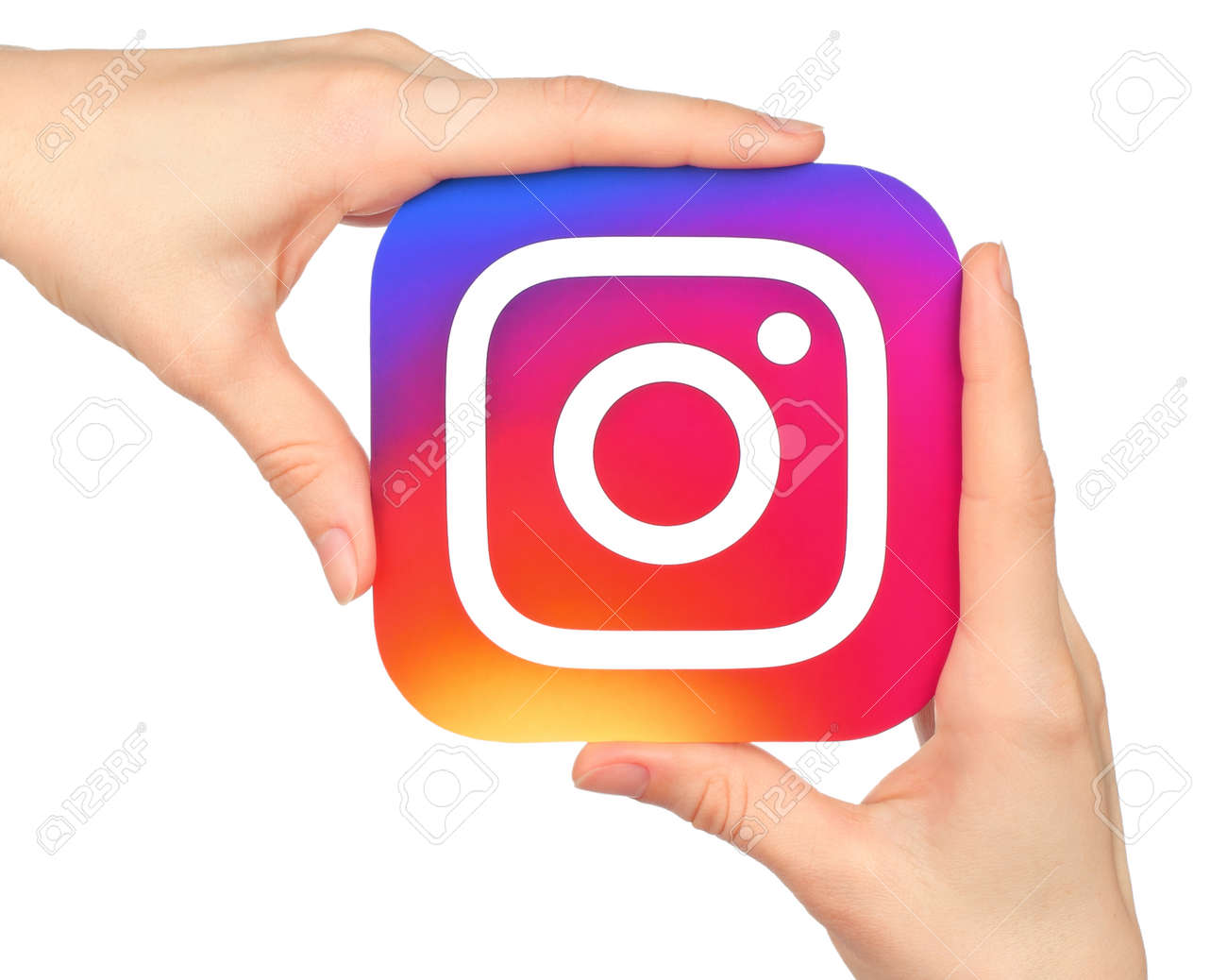 Kiev, Ukraine - January 20, 2016: Hands hold Instagram icon printed on paper. Instagram is an online mobile photo-sharing, video-sharing service - 80455285
