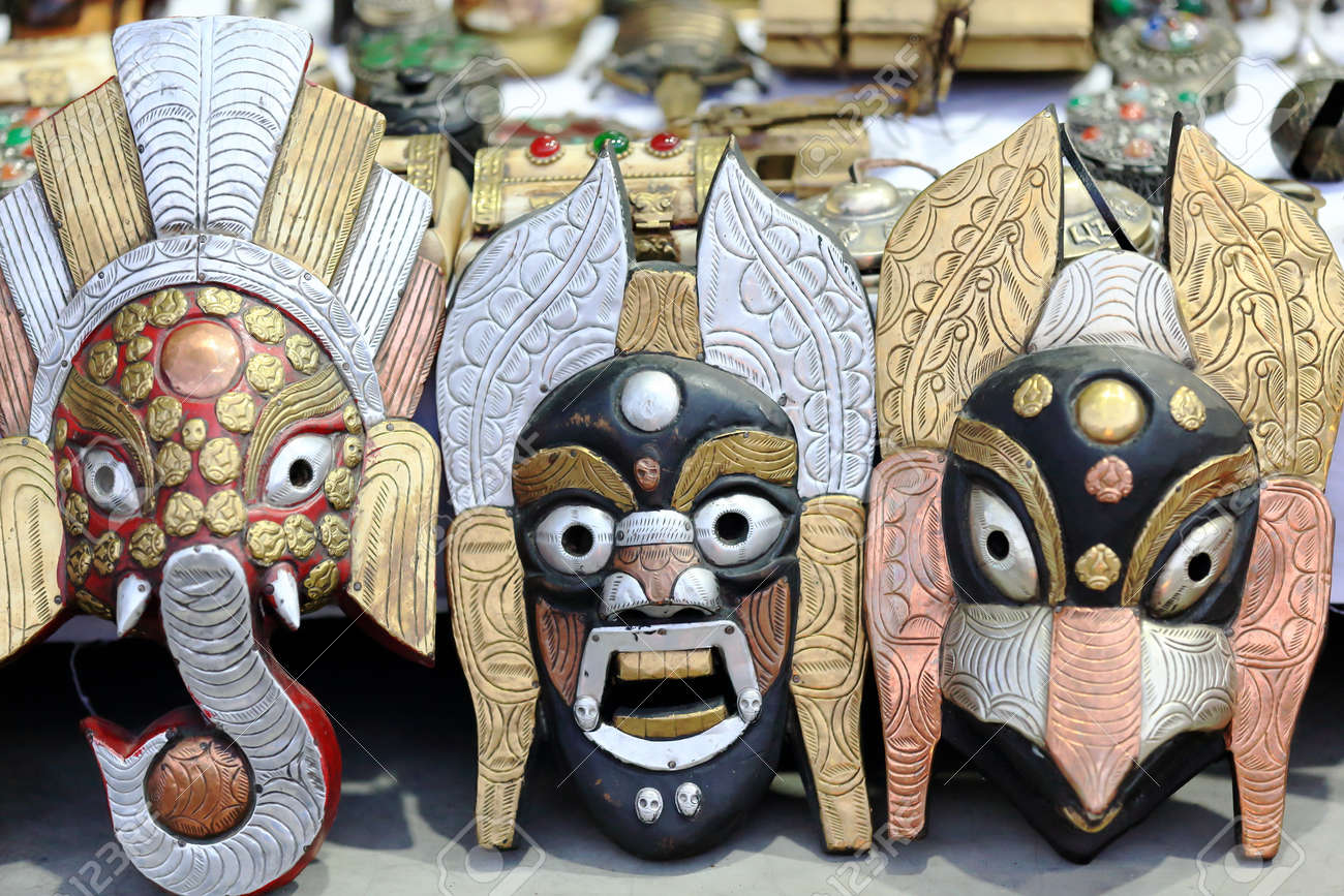 Nepalese Handicraft Polychrome Wood And Metal Masks Depicting