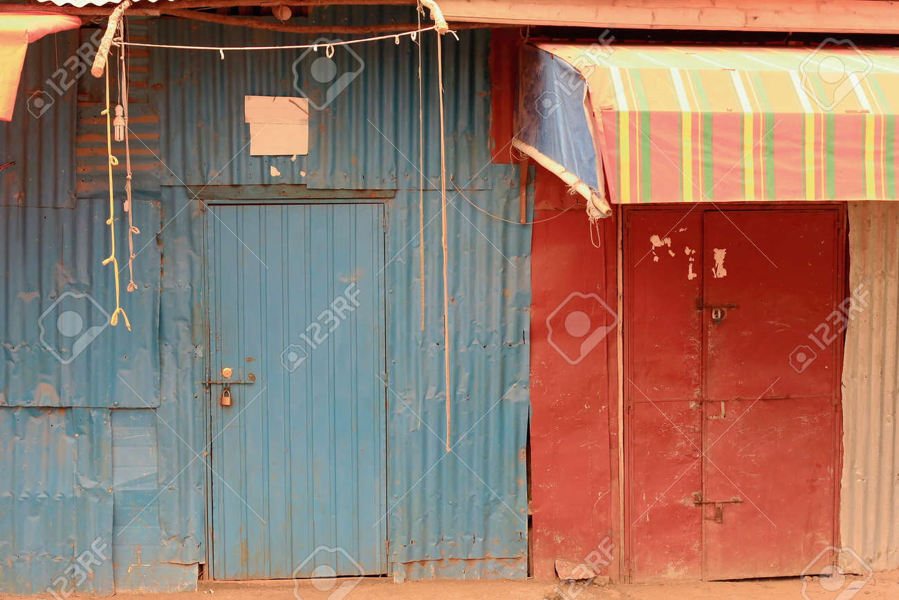 Stock Photo - Tin doors painted blue and red of closed shops in the area surrounding the Gebriel Bete-Saint Gabriel orthodox christian church. & Tin Doors Painted Blue And Red Of Closed Shops In The Area ...