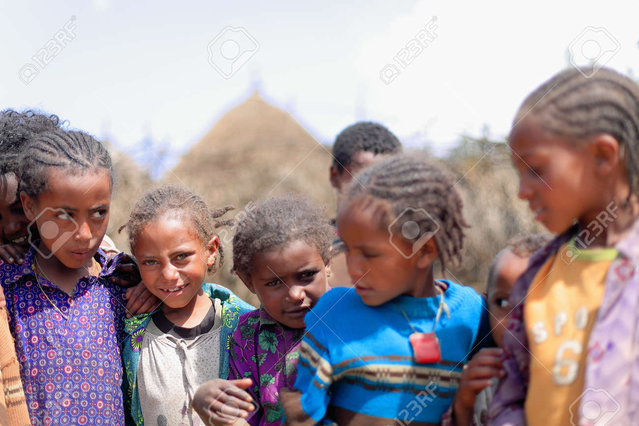 OROMIA, ETHIOPIA-MARCH 31: Local girls and boys swirl curiously