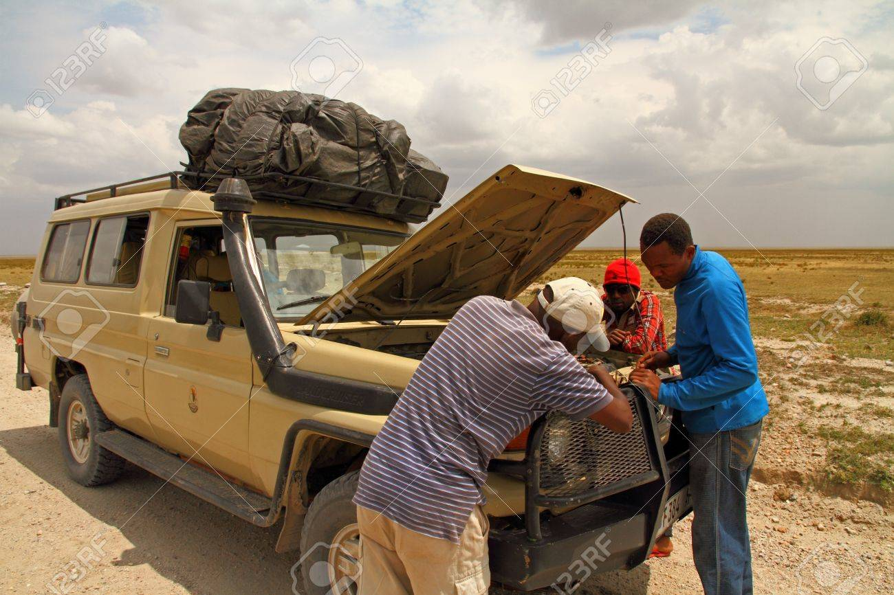 Fixing a broken down safari truck while on route Stock Photo - 17091619