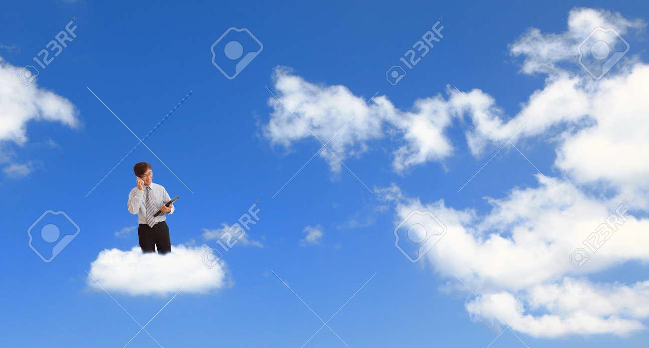 Cloud computing concept. Businessman holding a laptop Stock Photo - 10749733