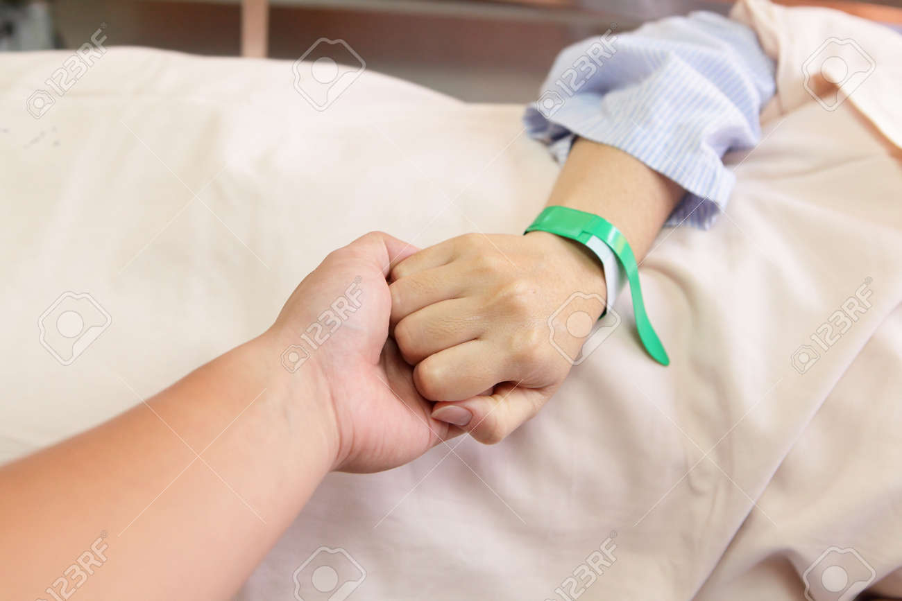 husband grip his wife hand before surgery in an operation room Stock Photo - 11145885