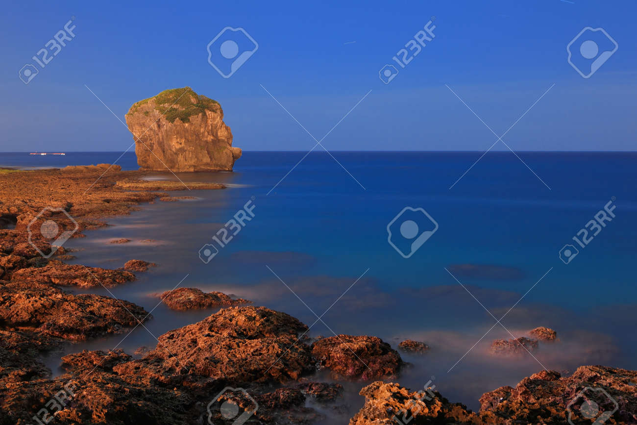 rock and wave in the moon light Stock Photo - 11343977