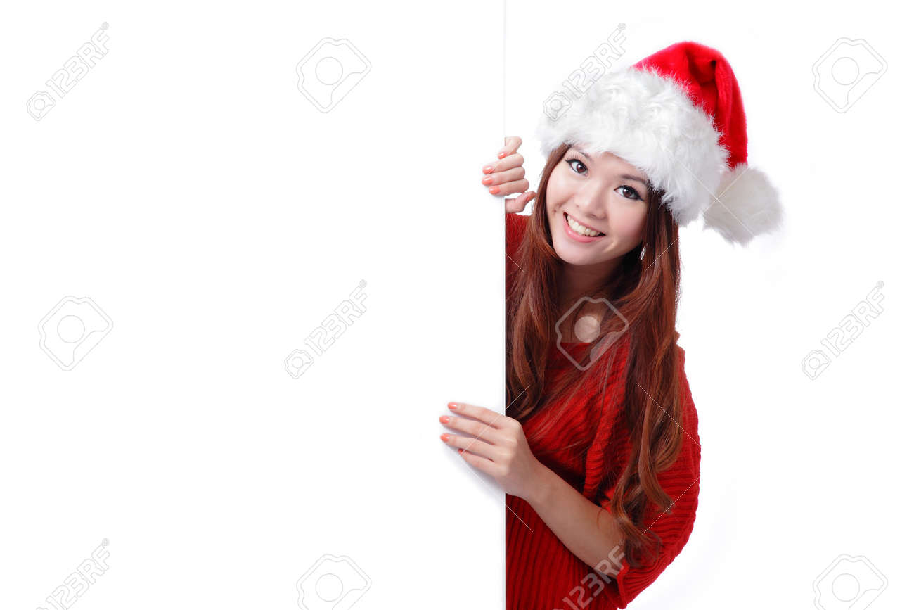 christmas young girl showing blank billboard banner sign smiling happy looking at camera. Beautiful and cute Asian female model Stock Photo - 11561072
