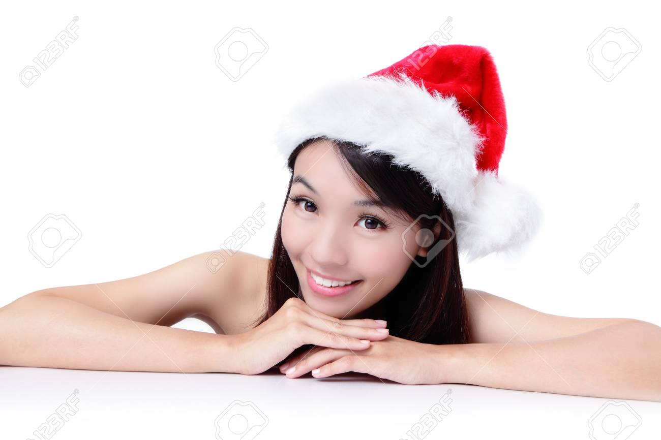 christmas young girl showing blank billboard banner sign smiling happy looking at camera. Beautiful and cute Asian female model Stock Photo - 11561167
