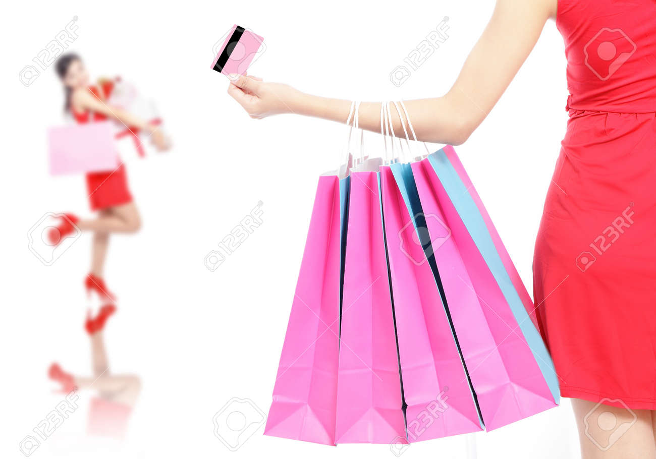 Shopping woman happy take credit card and shopping bag isolated on white background, model is a asian beauty Stock Photo - 11720502