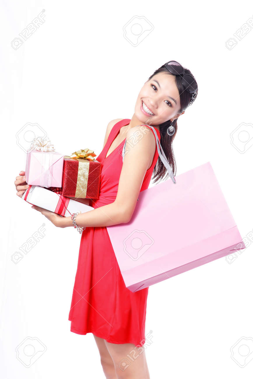 Shopping woman happy take big shopping bag and gift isolated on white background, model is a asian beauty Stock Photo - 11720543