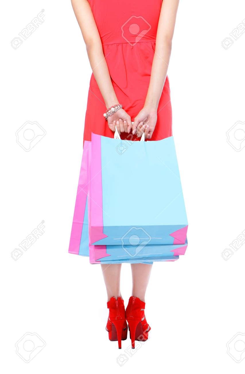 Sexy Legs of shopping lady showing shopping bag. Isolated on white background Stock Photo - 11720544