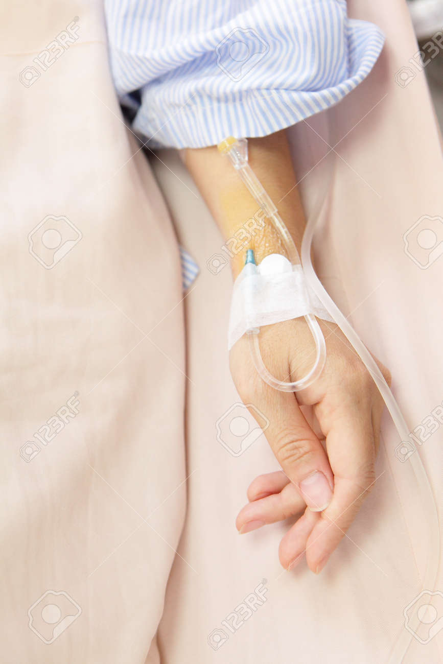 Patient's hand with an intravenous drip before surgery in an operation room Stock Photo - 11810297