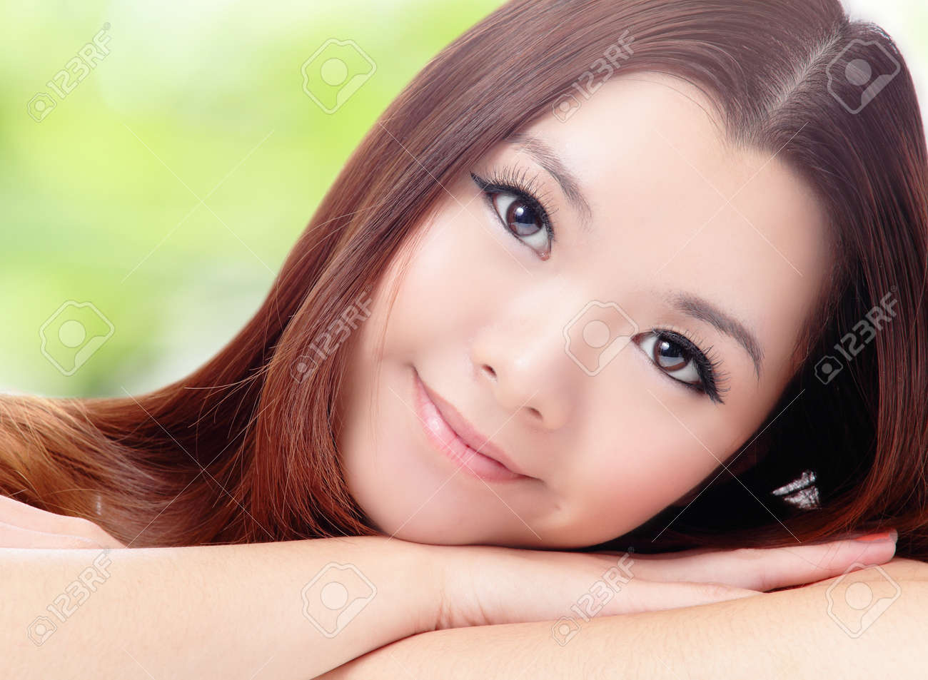 Close up of beautiful asian woman face with green background Stock Photo - 11937737