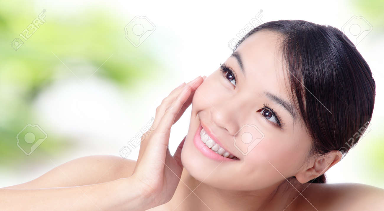 Close up of beautiful asian woman face with green background Stock Photo - 11937724