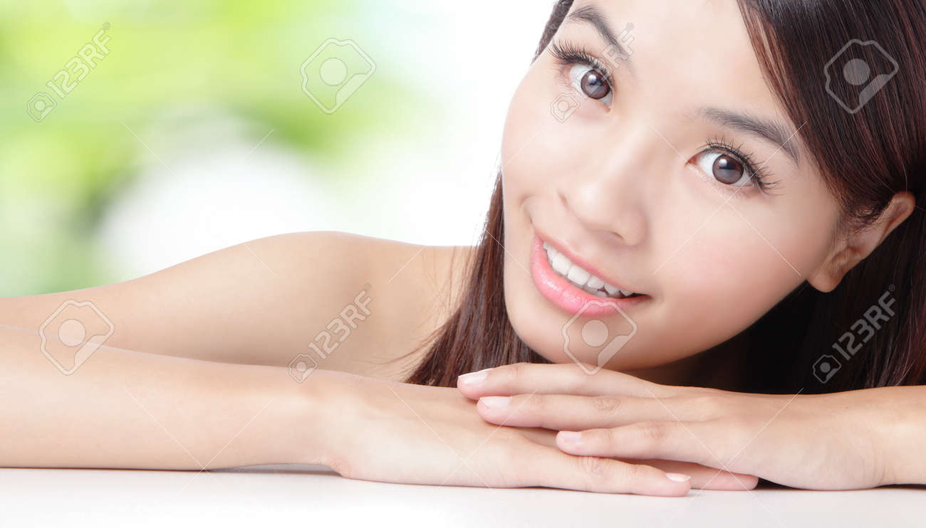 Close up of beautiful asian woman face with green background Stock Photo - 11937732
