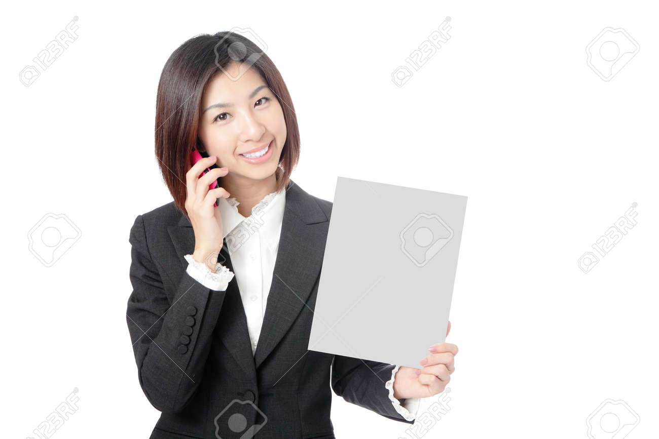 Beautiful Business woman take blank paper and speaking mobile phone isolated on white background, model is a asian beauty Stock Photo - 11966943