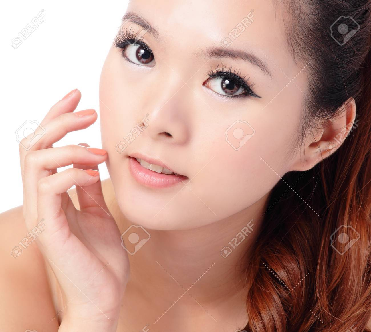 Asian beauty skin care woman smiling close-up, Beautiful young woman touching her face looking to the side. Isolated on white background Stock Photo - 12209035