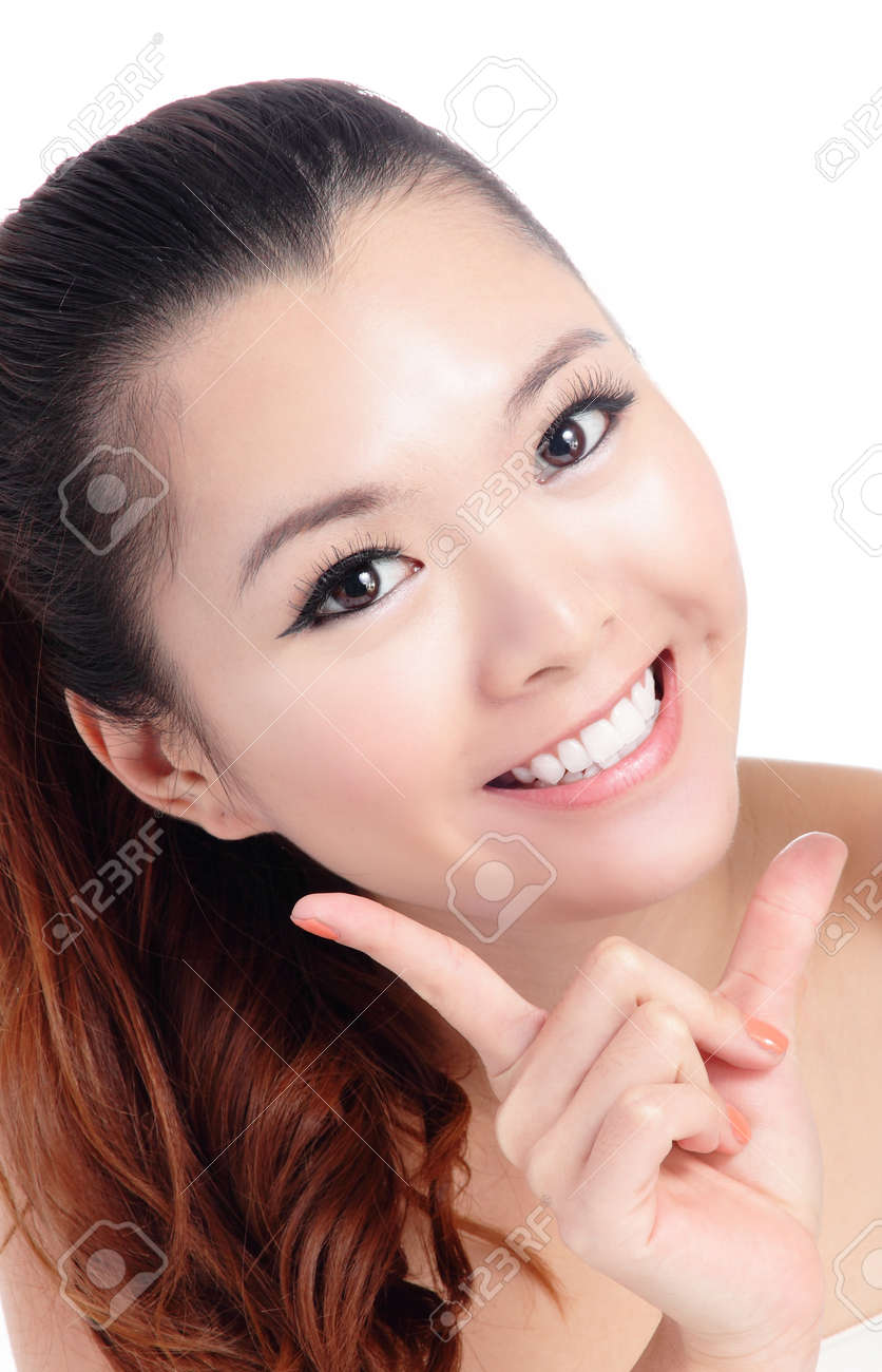 Fresh smiling woman face close up with hand isolated on white background, model is a asian beauty Stock Photo - 12209034