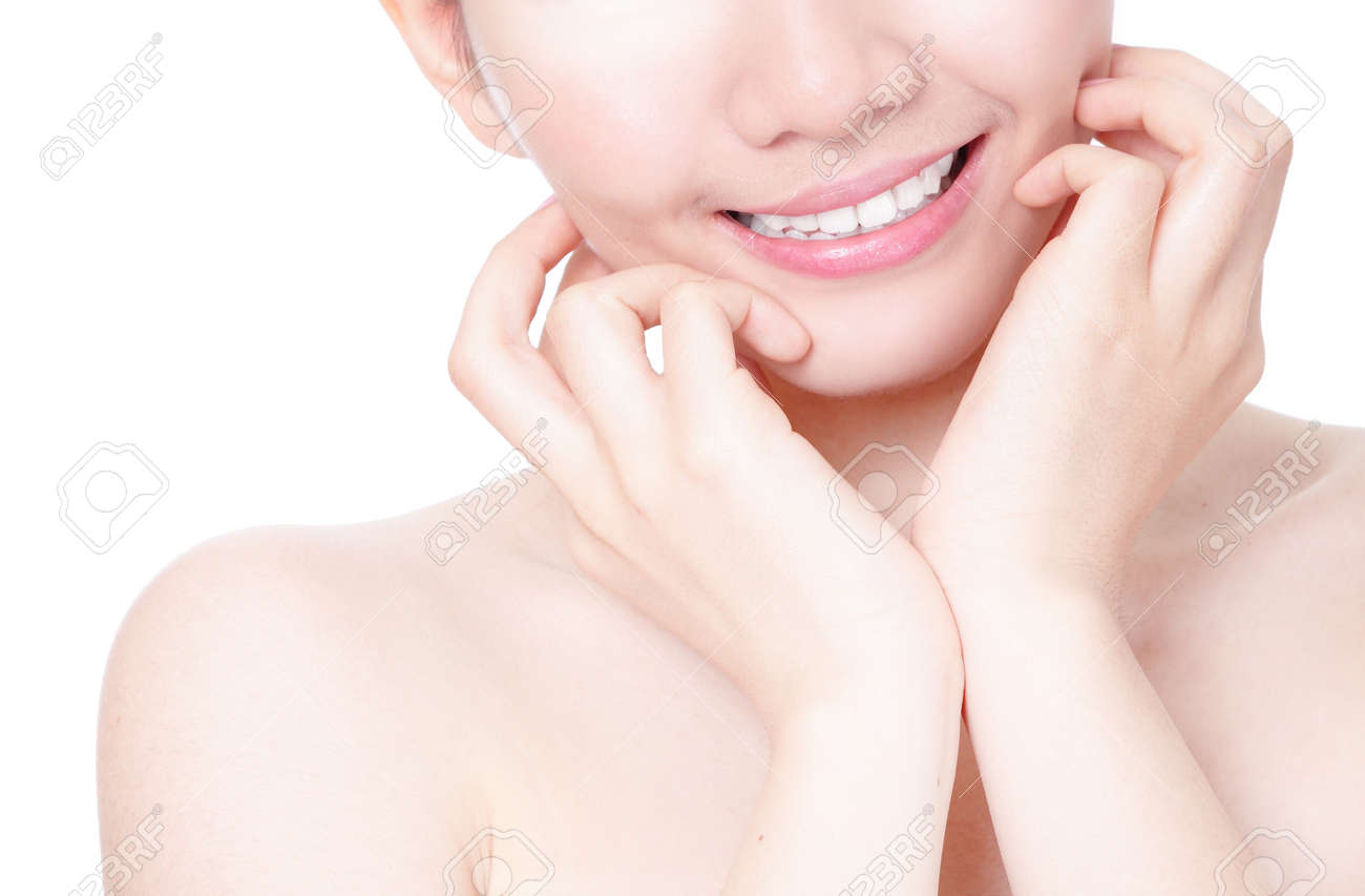 Close up of girl mouth with sweet smile and hand finger touch face isolated on white background, model is a asian beauty Stock Photo - 13052399