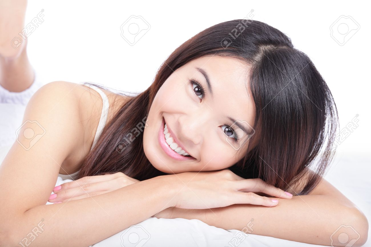 close up portrait of woman smile face lying on bed isolated on white background, model is a asian girl Stock Photo - 13224277