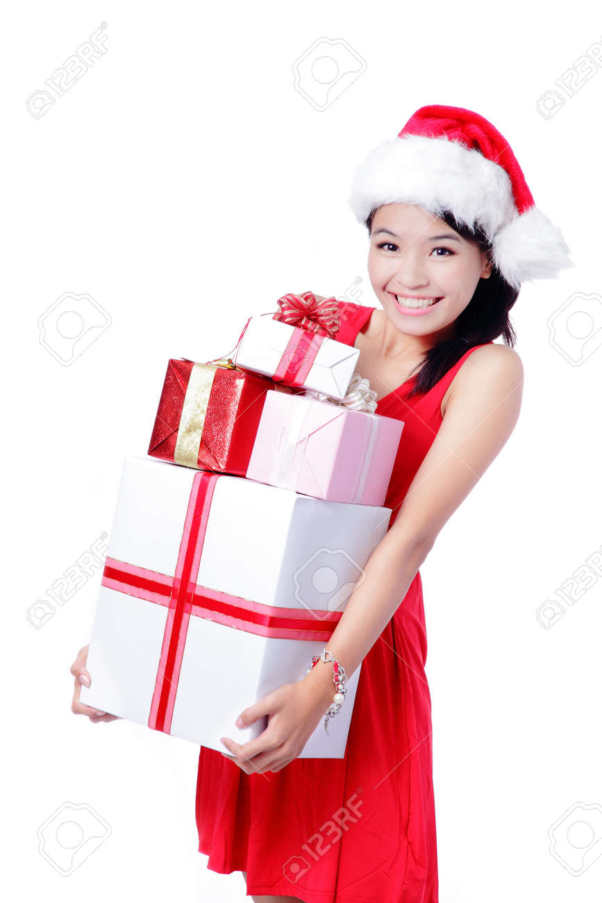 Young Happy Girl In Christmas Hat Holding Huge Christmas Gift ...