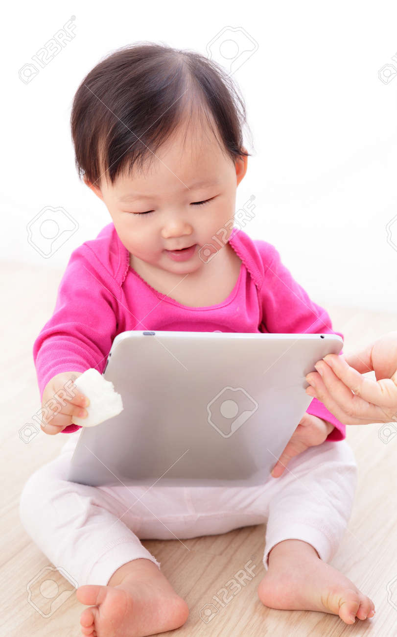 Girl baby happy play game with tablet PC. asian child smile Stock Photo - 16686199