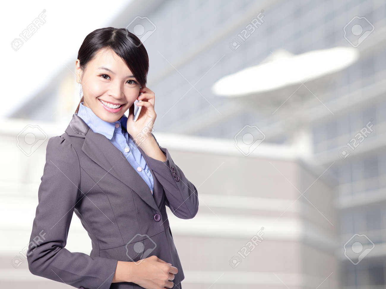 Beautiful smiling business woman speaking mobile phone at office, asian beauty model Stock Photo - 16949413