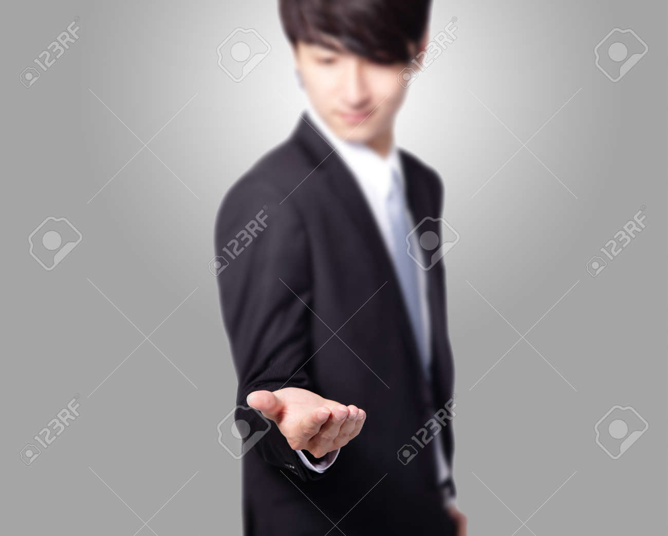 handsome Business man with empty hand on gray background, great for you design, asian model Stock Photo - 17034787