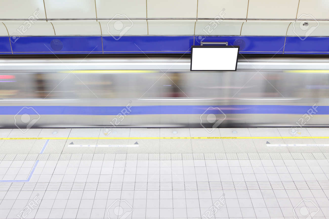 platform at a metro railway station with motion blur speed train and blank tv billboard Stock Photo - 17188627