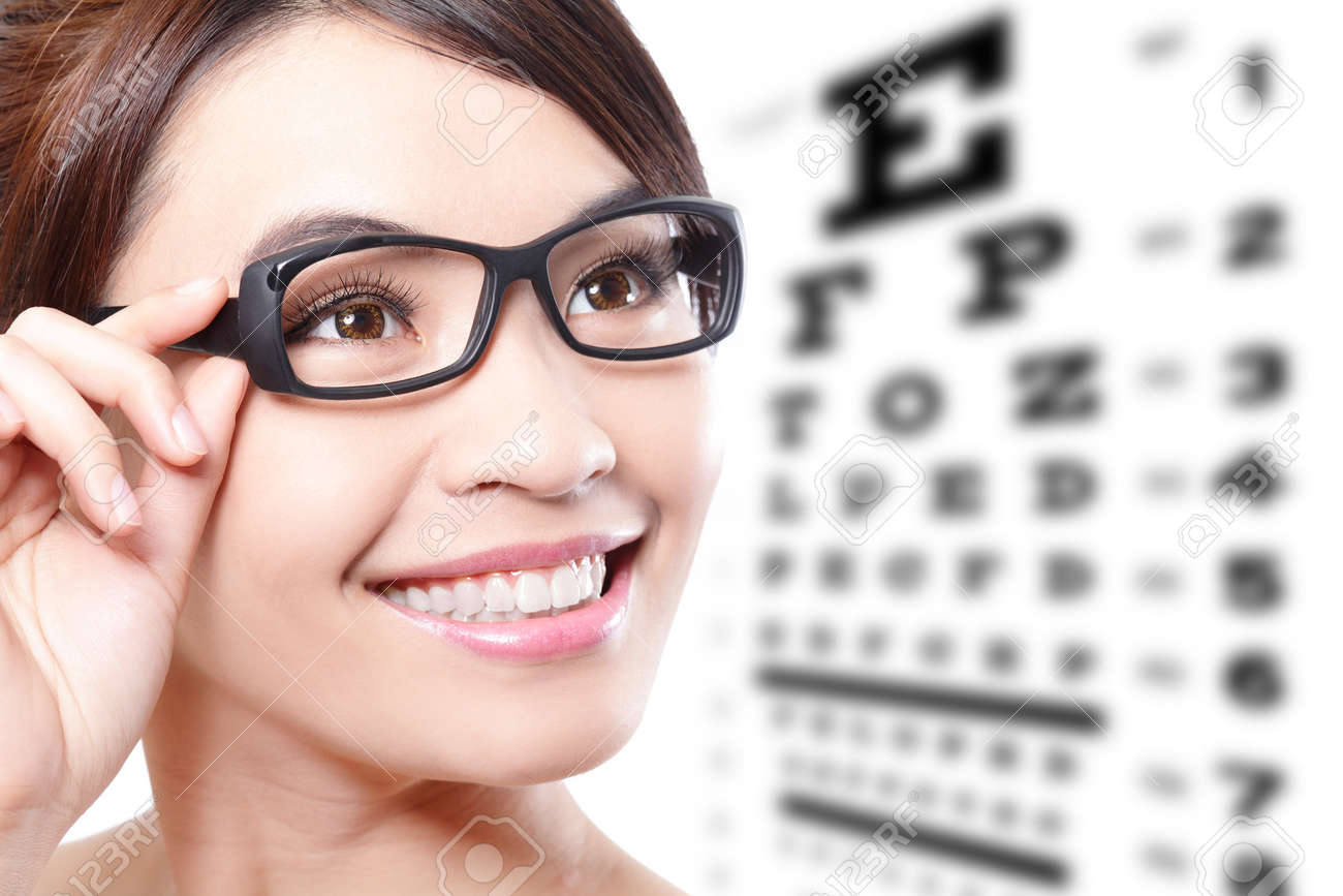 beautiful woman with glasses on the background of eye test chart,