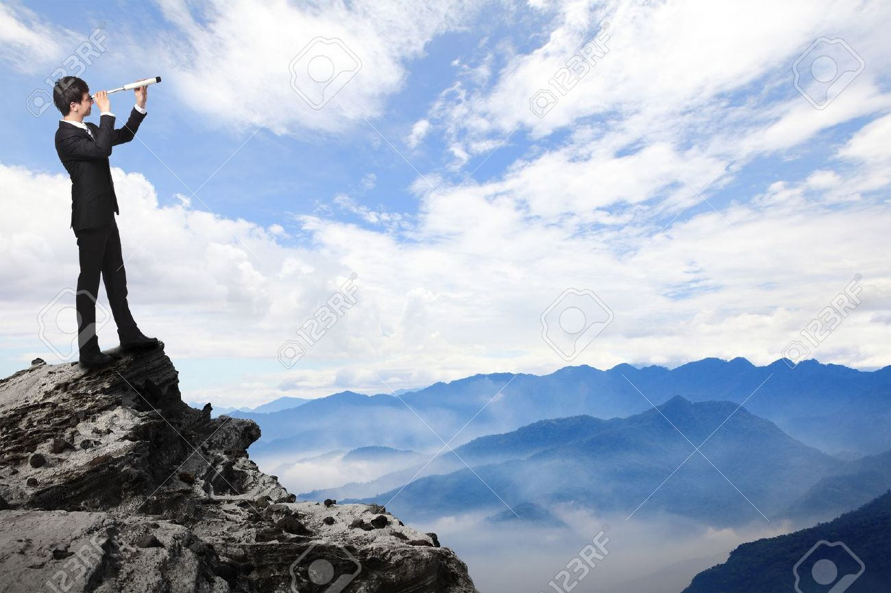 business man looks through a telescope on the top mountain. concept for business, leadership, success, Stock Photo - 20240466