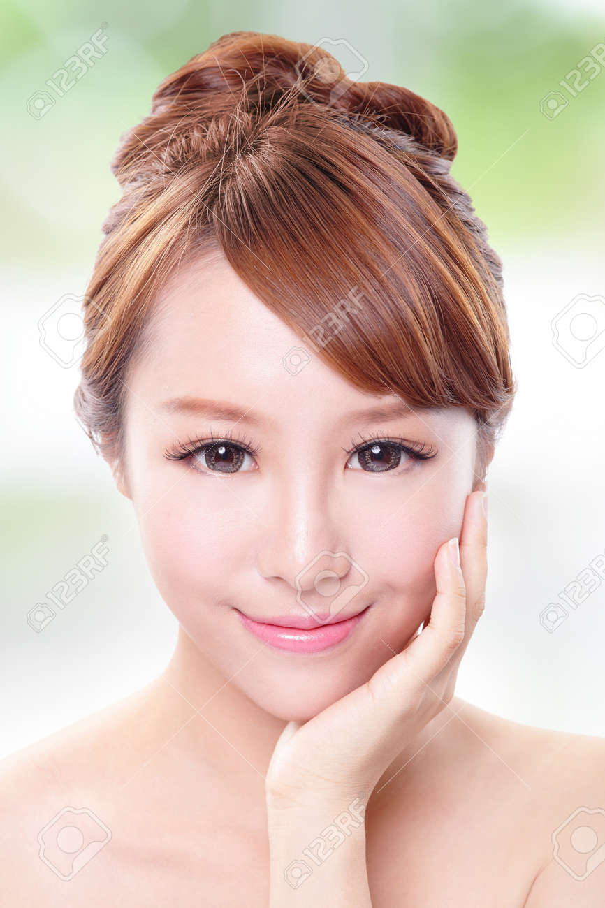 portrait of the woman with beauty face and perfect skin isolated on green background Stock Photo - 21088101